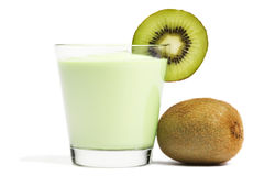 Milkshake with a blade of kiwi and kiwifruit aside Royalty Free Stock Image