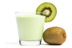 Milkshake with a blade of kiwi and kiwifruit aside Royalty Free Stock Image