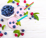 Milkshake with blueberries Stock Photos