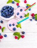 Milkshake with blueberries Stock Images