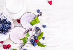 Milkshake with blueberries Royalty Free Stock Images