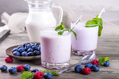 Milkshake with blueberries Royalty Free Stock Photos