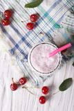 Milkshake cherry in a glass. vertical top view Stock Image