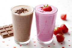 Milkshake do chocolate e da morango Foto de Stock