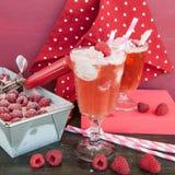 Milkshake float with raspberry ice cream. Milkshake soda with ice cream and fresh raspberries Stock Photo