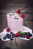 Milkshake with fresh berries Royalty Free Stock Photos