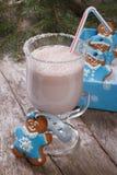 Milkshake and gingerbread men Royalty Free Stock Photos