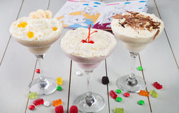 Milkshake in a glass with candies Stock Photography