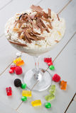 Milkshake in a glass with candies Stock Images