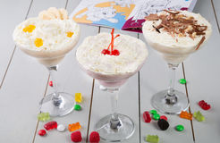 Milkshake in a glass with candies Royalty Free Stock Images