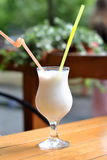Milkshake with a glass of tubes Stock Images