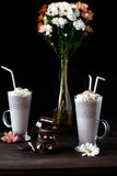 Milkshake with ice cream. Chocolate cookies and whipped cream Royalty Free Stock Photography