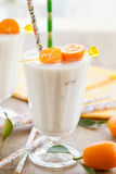 Milkshake with kumquats Royalty Free Stock Photo