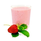 Milkshake with a one strawberry and leaf Royalty Free Stock Images