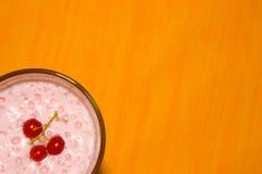 Milkshake on orange background Stock Image