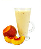 Milkshake with peach slices Stock Images