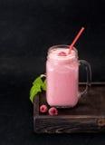 Milkshake with raspberries. In a glass jar Stock Photos