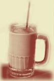 Milkshake In Sepia. Chocolate milkshake in a sepia tone royalty free stock images