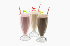 Milkshake vanilla, chocolate, strawberry Royalty Free Stock Photography