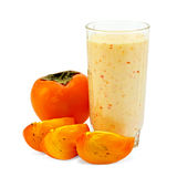 Milkshake with whole persimmon Royalty Free Stock Photography