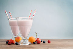 Milkshake on wodeen table Stock Image
