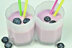 Milkshake Yoghurt Blueberry, Macro. Close up of two milkshakes with yogurt and blueberries, macro, detail, full frame, horizontal royalty free stock photos