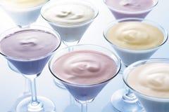 Milkshakes. Several cocktail glasses filled with irresistible milkshakes stock photography