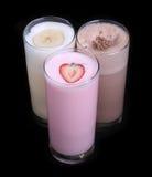 Milkshakes chocolate flavor ice cream set collection isolated. On black background royalty free stock photos