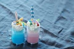 Milkshakes. Delicious milkshakes on the table stock image