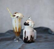 Milkshakes. Delicious milkshakes on the table stock photography