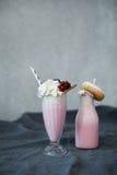 Milkshakes. Delicious milkshakes on the table royalty free stock photo