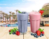 Milkshakes on desk. Fruit banana yogurt drink fresh strawberry stock image