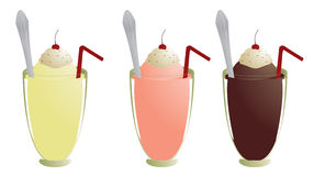 Milkshakes isolated. Milkshakes with topping straw and spoon isolated on white Royalty Free Stock Photo