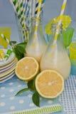 Milkshakes and oranges Royalty Free Stock Image