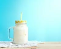 Milkshakes. Put on wooden in blue wall room. Pastel tone royalty free stock image