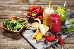 Milkshakes and smoothies. Assortment of milkshakes and smoothies on wooden table stock image