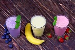 Milkshakes. Strawberry, banana and blueberries milkshakes Royalty Free Stock Image