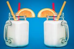 Milkshakes in vintage style. In background royalty free stock image
