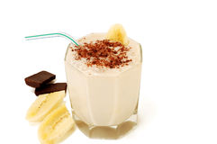 Milky banana cocktail with slices of banana and ch Stock Images