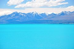 Milky blue water of Lake Pukaki, New Zealand. Milky blue water of Lake Pukaki with beautiful view on Southern Alps in the background stock photos