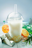 Milky bubble tea with fruit and boba balls Royalty Free Stock Images