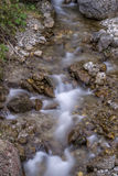 Milky river with golden rocks Royalty Free Stock Photography