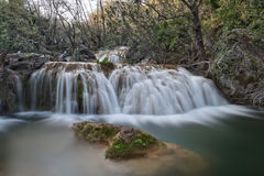 Milky Smooth Waterfall. Silky Smooth Waterfall with Mossy Rocks royalty free stock photo