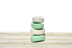 Milky soaps. Pile of milky soaps on white wooden surface Stock Photo