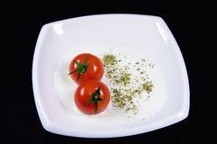 Milky soup with tiny red tomatoes Stock Photo