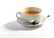 Milky tea in a cup with a teaspoon Royalty Free Stock Photo