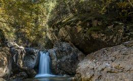Milky Waterfall. Small milky waterfall in Bucegi Natural Park, Romania Royalty Free Stock Photo