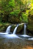 Milky waterfall under romantic bridge Royalty Free Stock Photo
