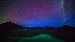 Milky way above Lake Segara Anak inside crater of Rinjani mountain on night sky. Lombok island, Indonesia.