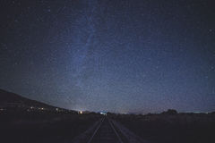 Milky way above railroad Royalty Free Stock Photo